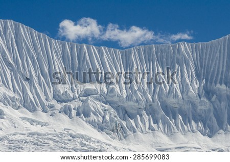 Ice wall near Chuckhung village in Everest region - stock photo