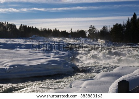 Ice waterfall Storforsen in the north of Sweden - stock photo