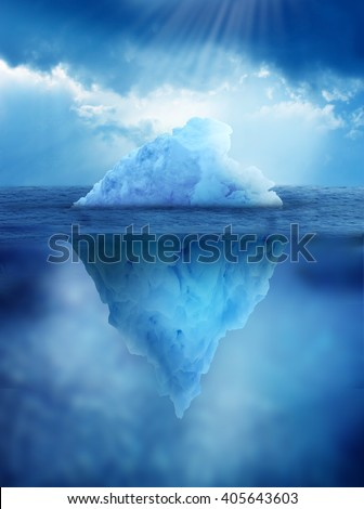 Iceberg, above and below water's surface - stock photo