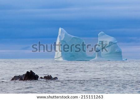 Iceberg along the coast of Newfoundland. - stock photo