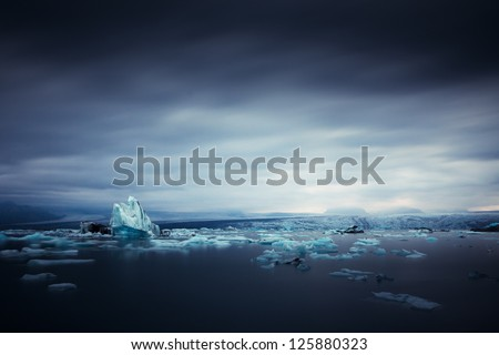 iceberg and ice at jokulsarlon lake - stock photo