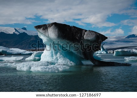 iceberg floating at Jokulsarlon - stock photo