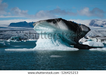 iceberg floating in Jokulsarlon lagoon - stock photo