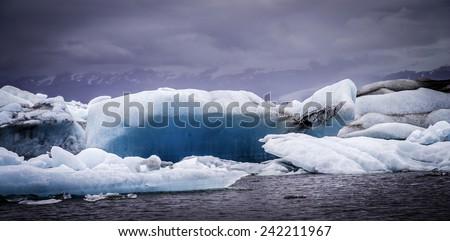 Iceberg floating in the bay at Jokulsarlon, Iceland - stock photo