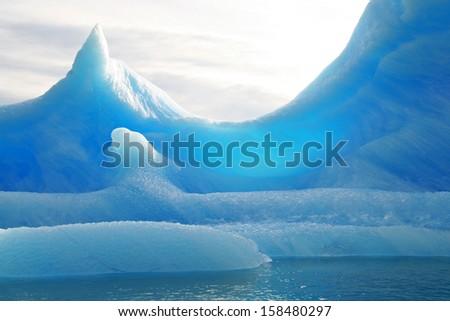 Iceberg floating on the sea - stock photo