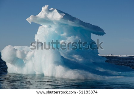 Iceberg in Nunavut with sunshine (canadian arctic sea) - stock photo