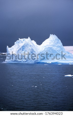 Iceberg in Paradise Harbor, Antarctica - stock photo