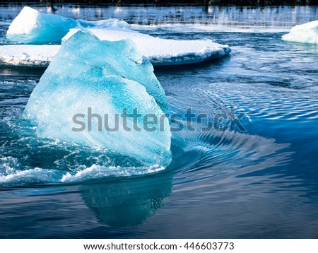 Iceberg in the rushing Water of a river in Iceland - stock photo