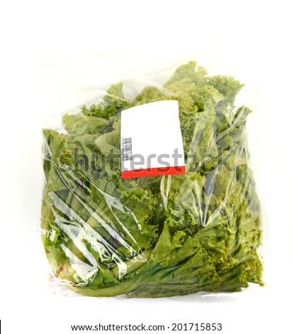 iceberg lettuce in plastic bag package with price tag - stock photo