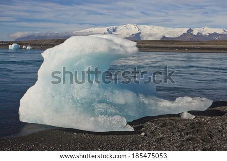 Iceberg on the beach of Jokulsarlon Lagoon- the famous ice land in iceland - stock photo