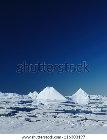 Icebergs and ocean. Peculiar landscape of the Antarctica. - stock photo