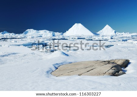 Icebergs and ocean. Peculiar landscape of the Antarctica. - stock photo