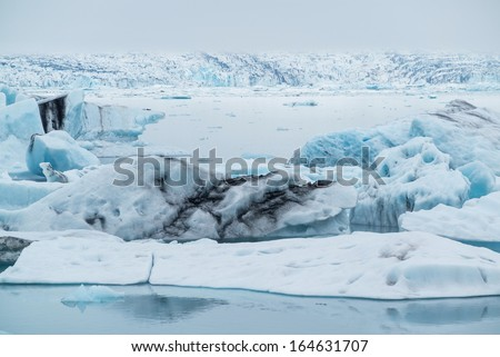 Icebergs float at Jokulsarlon, after breaking from the glacier - stock photo