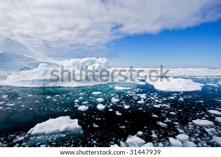 Icebergs in a wide perspective in the fjord of Ilulissat, Greenland. - stock photo