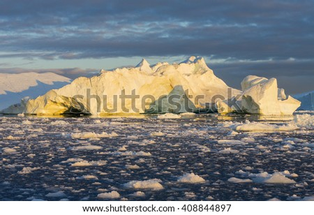 Icebergs in Disko Bay Greenland. Ices and icebergs of unusual forms and colors. - stock photo