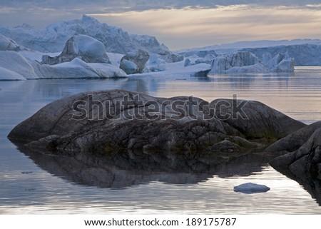 Icebergs in Ilulissat Icefjord, Greenland - stock photo