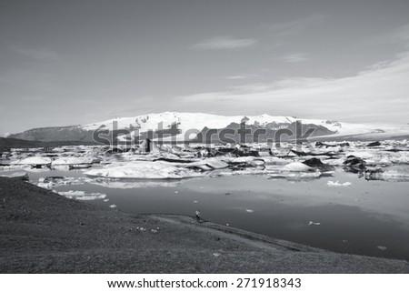 Icebergs in Jokulsarlon lagoon, Iceland. Black and white toned image. - stock photo