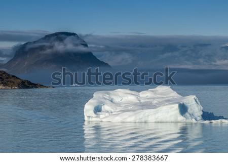 Icebergs in Narsuaq at sunset - stock photo