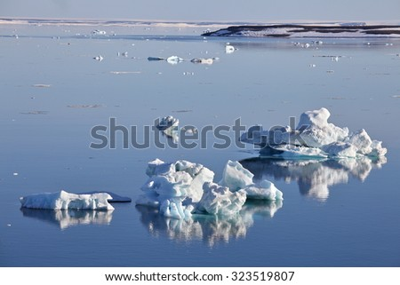 Icebergs on still water - stock photo