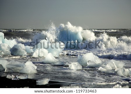 Icebergs on the black volcanic beach Iceland - stock photo