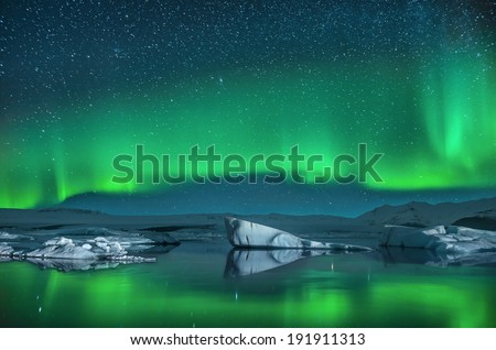 Icebergs under the Northern Lights - stock photo