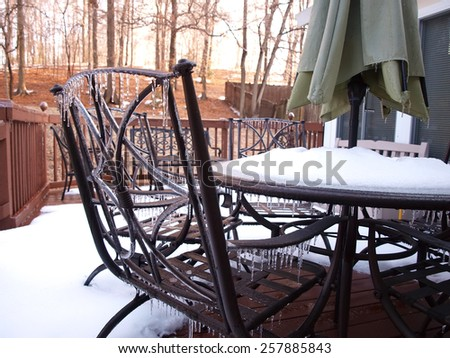 icecycles that formed on patio furiture during a winter cold spell - stock photo