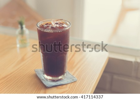 Iced Americano black coffee serve in cafe. - stock photo