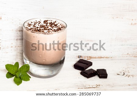Iced chocolate milkshakes in glass on wooden table - stock photo