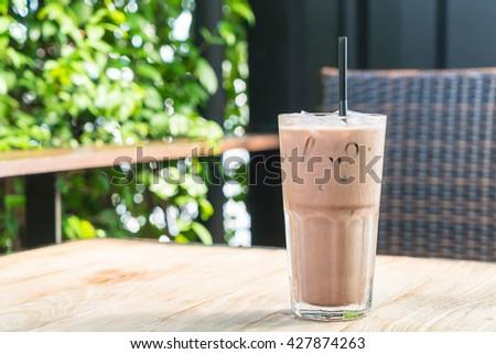 Iced Chocolate on wood table - stock photo