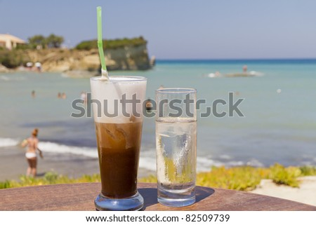 iced coffee in an exotic beach - stock photo