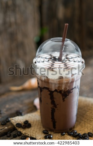 Iced coffee mocha on wooden table - stock photo