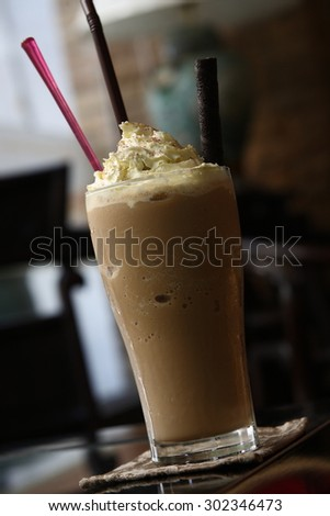 iced coffee on wood table - stock photo
