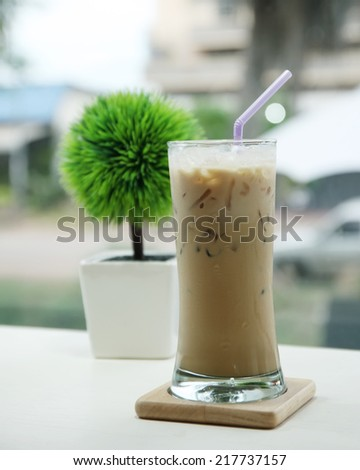 iced Coffee with artificial flowers Reap in a coffee shop. - stock photo