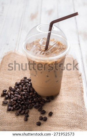 Iced coffee with coffee beans - stock photo