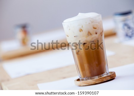 Iced coffee with soft cream on table - stock photo