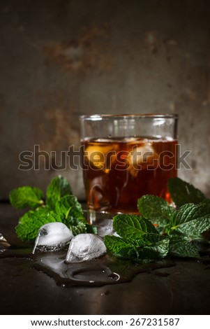 iced cube with fresh mint ingredient for cocktail in night party - stock photo