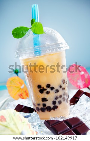 Iced drink with chocolate and a touch of green leaves on top for contrast - stock photo