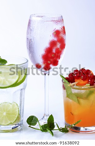 Iced drinks garnished with fresh fruit  - stock photo