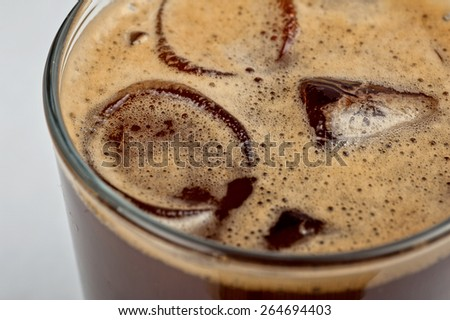 Iced espresso coffee in glass on a white - stock photo