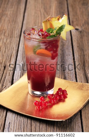 Iced fruit beverage in glass - stock photo