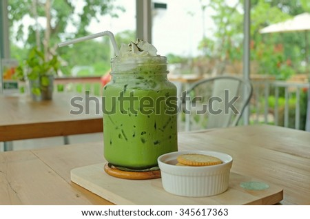 Iced milk green tea smoothies and whipped cream serve with biscuits - stock photo
