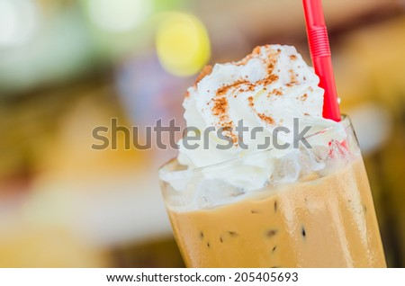 Iced mocha coffee with whip cream on top - stock photo