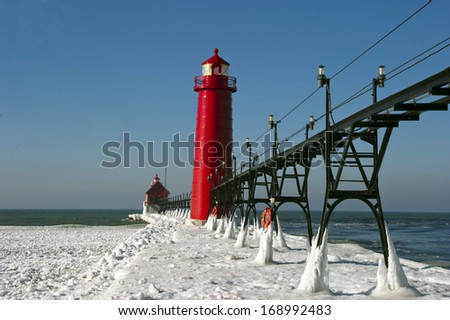Iced over pier, Grand Haven Lighthouse  - stock photo