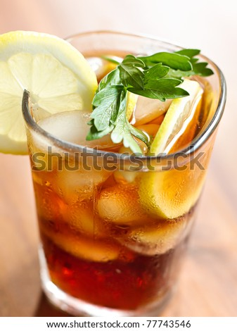 iced tea closeup with selective focus on garnish. - stock photo