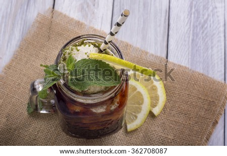 Iced Tea with Lemon & Fresh Mint leaves - stock photo