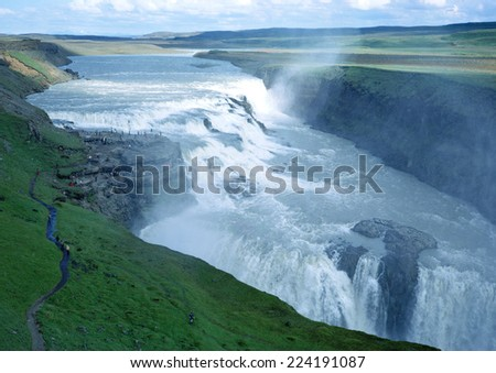 Iceland, Gullfoss waterfall, cascade and spray in green landscape - stock photo