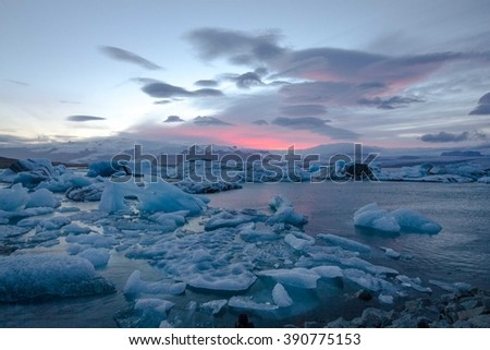 Iceland iceberg with pink sky  - stock photo