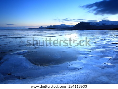Iceland in twilight over the mountain range nd lakes - stock photo