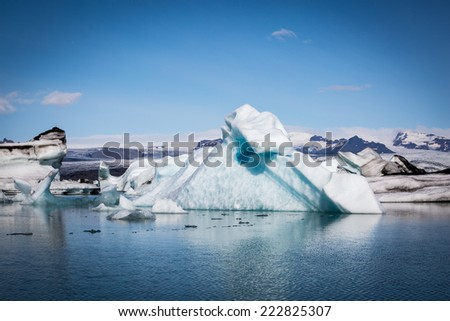 Iceland, Jokulsarlon Glacier Lagoon, blue icebergs and clear sky in a sunny day - stock photo