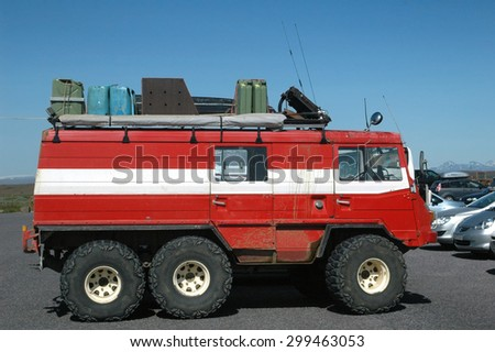 ICELAND - JULY 2009: A heavy duty off-road vehicle pictured in Iceland circa 2009.  Heavy duty vehicles are required to drive across frozen winter landscapes, glaciers and  mountain roads - stock photo
